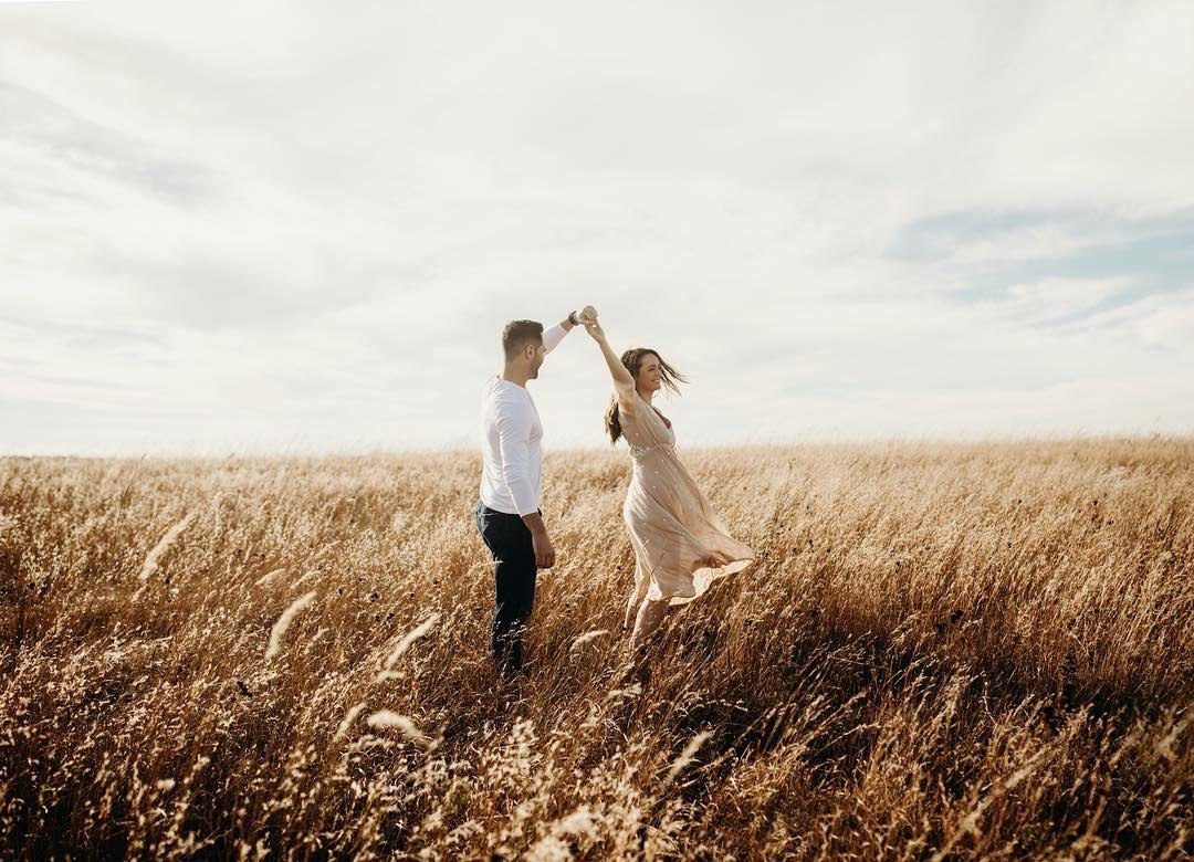images of romantic couple walking in rain